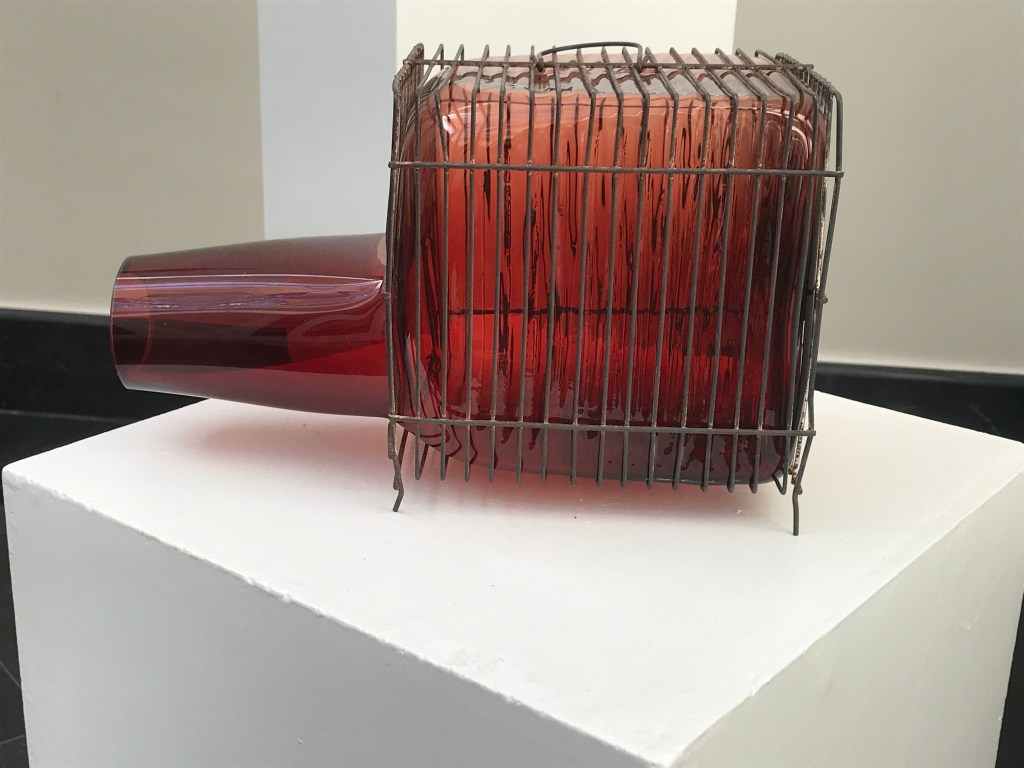 Fascinating glass objects in Marbella a red gals in a cage