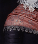 Detail of costume, sash and collar
