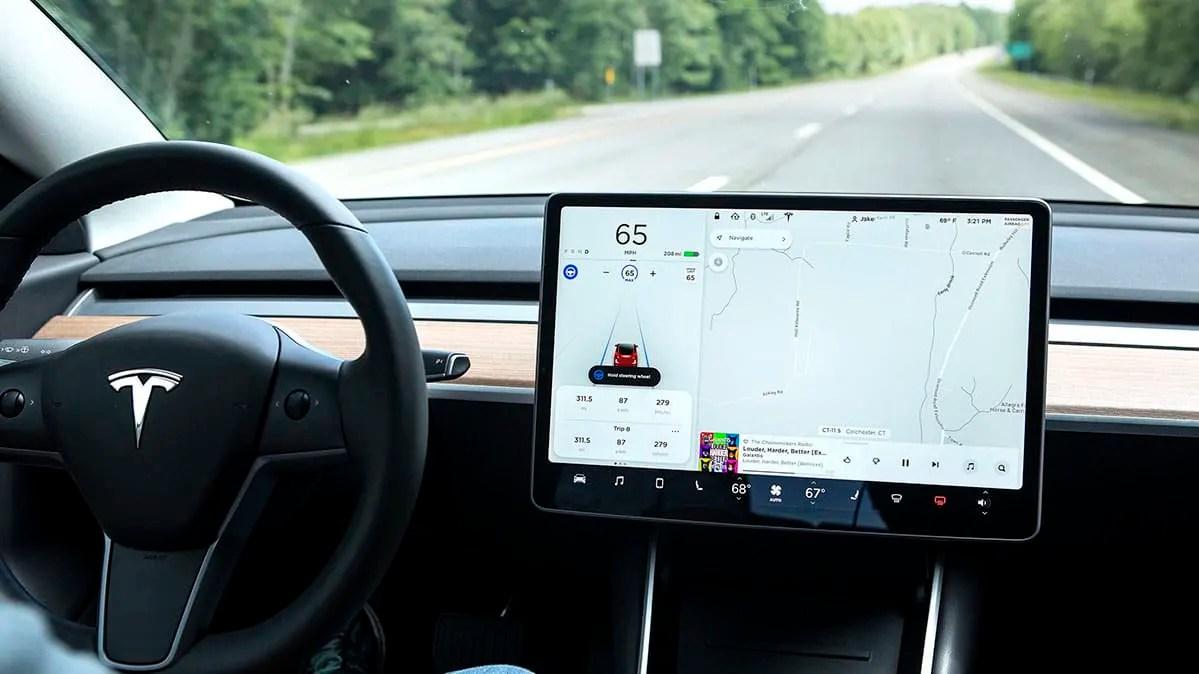 tesla autopilot update warns