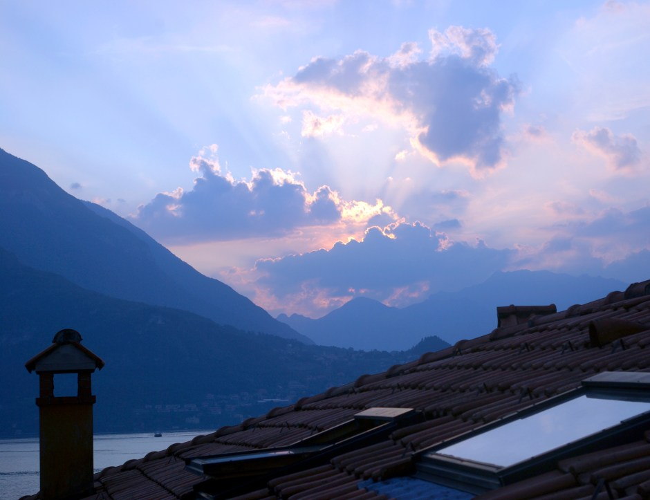 Sunset over a roof in Varenna.  Photography by L.E. Paulson