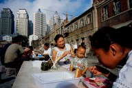 Low-rise community is displaced by high-rise modernity. Dalian-2005
