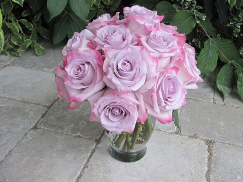 "Fresh roses always make a great statement. Aside from the traditional red, we have gorgeous ""purple haze"" and two-tone ""sweetness"" varieties. Starting at $29.00 for a half dozen with fresh greenery and fillers."
