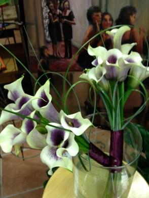 Two-tone mini calla lilies make elegant bridesmaids' bouquets.