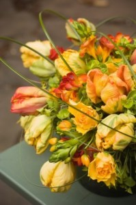 Tulips and freesia encircled with bear grass.