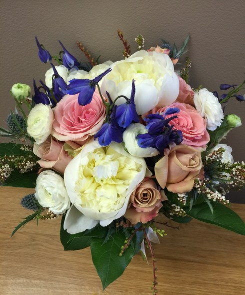 Sarah's bouquet of white peonies, pink and beige roses, blue delphinium and ranunculus.