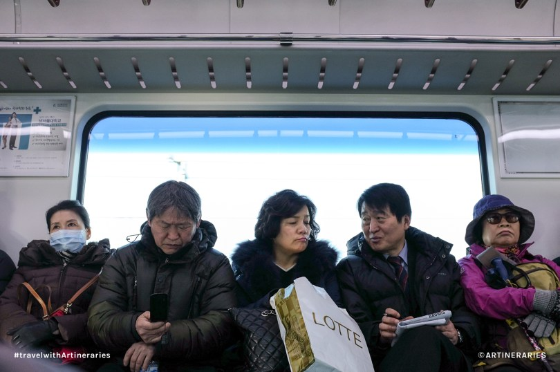 A photo of locals in the train while on our way to Suwon. Photo by Ivan Angelo