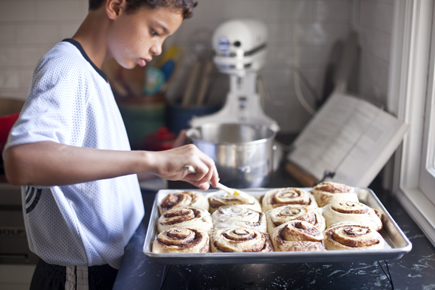 Spreading icing on cinnamon rolls | Artisan Bread in Five Minutes a Day