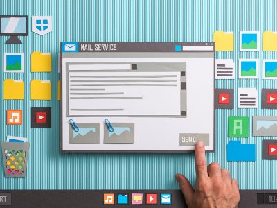User sending an e-mail text with attachments using an e-mail client, he is pressing the send button, collage and paper cut composition