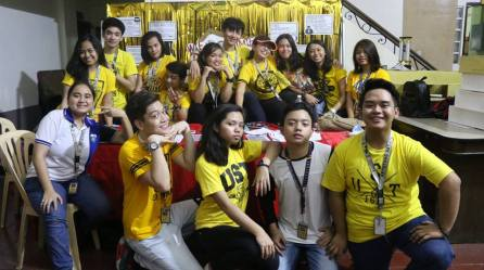 S36 sophomores at their recruitment booth at the St. Raymund de Peñafort Bldg, UST.