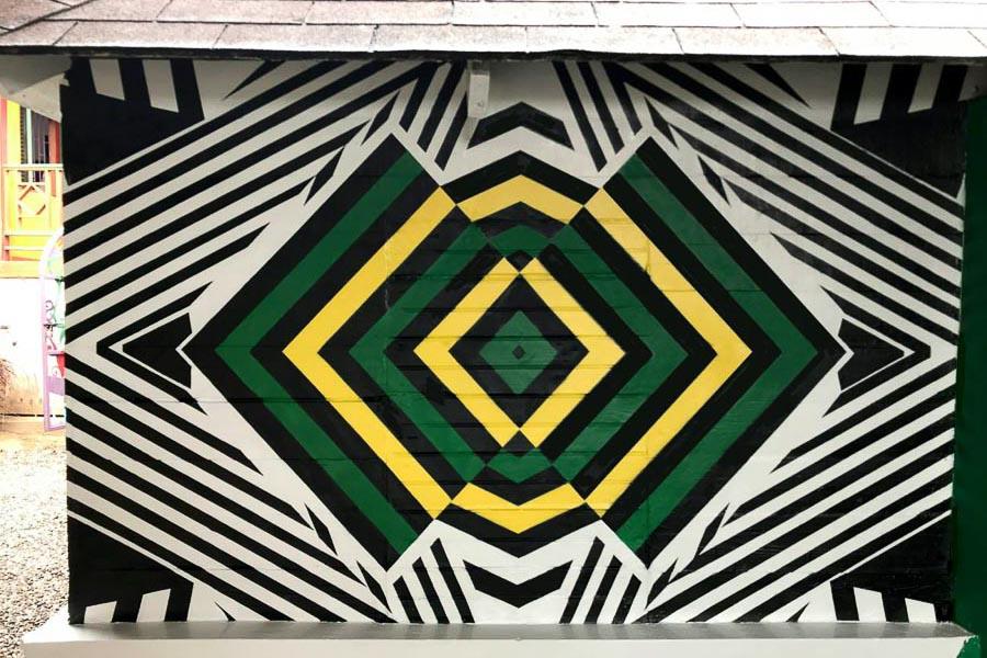 Lions Eye. Bob Marley's Mausoleum, 9 Mile, Jamaica, December 2018. Abstract interruption of the Jamaica flag. –Lindz & Lamb