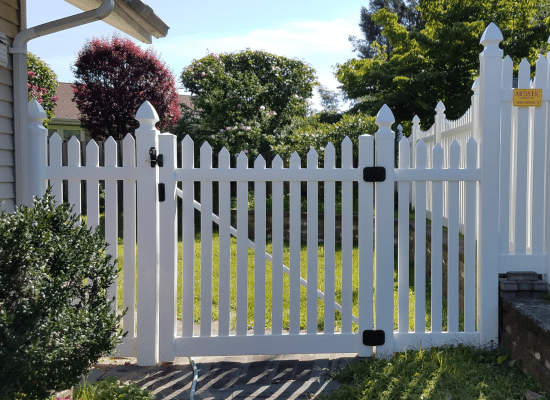 A White pvc scalloped gate installed by Artistic Fence of northern NJ