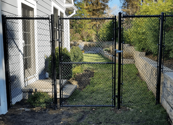 Black chain link fence and gate at a residential property in New Jersey