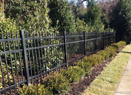 Traditional style black aluminum fence