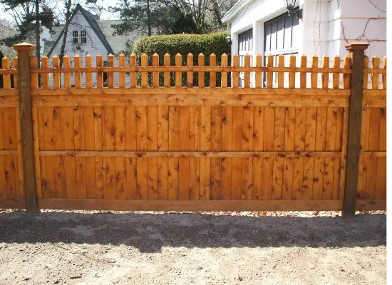 Solid wood fence with open topper