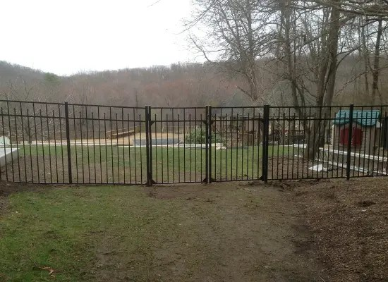 Black aluminum fence with single gate