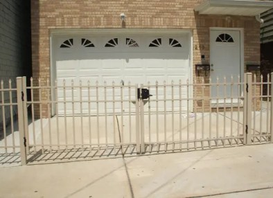 Tan Aluminum fence with driveway gate