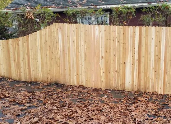 Solid wood picket fence