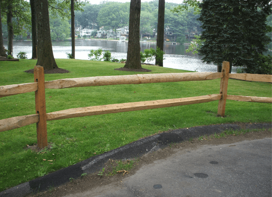 Solid wood privacy fence with stain