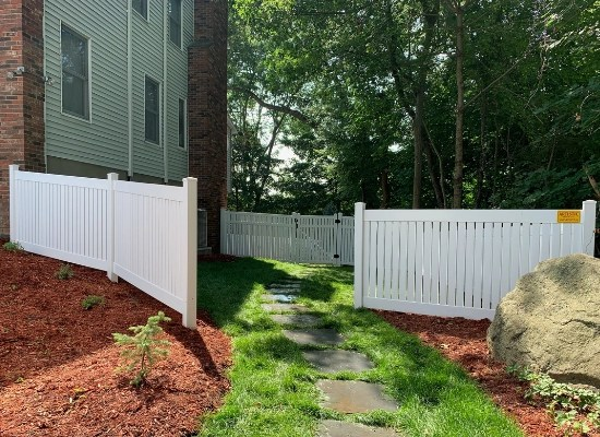 Semi-privacy vinyl fence with opening that leads to privacy fence with gate in the back