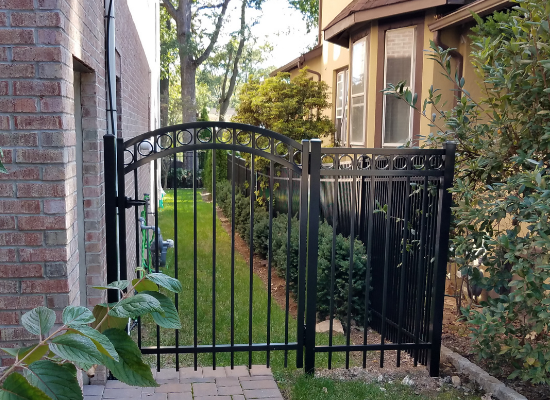 Black aluminum fence and gate with circle embellishments
