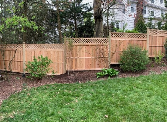 Stepped Wood privacy fence with lattice top