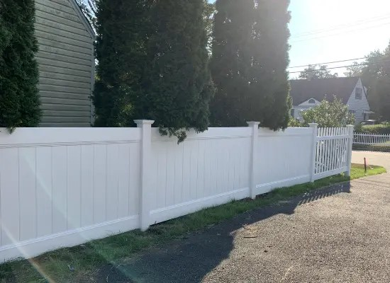 4 foot hight white vinyl Deco Rail privacy fence and picket fence installed along a driveway in Haskell, New Jersey