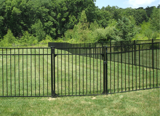 Black aluminum fence in a residential backyard