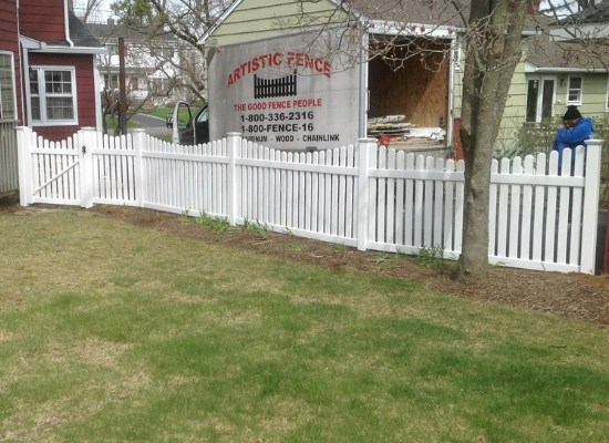 Scalloped White Picket Fence with Artistic Fence Company truck in the background