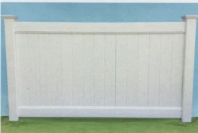 Suburban vinyl privacy fence with deco rail has a picture frame type look thanks to the decorative railings