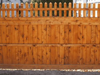 Stained wood fence with open top