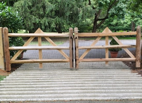 Diamond three rail split rail double gate made of wood with decorative traiangles