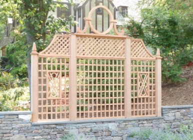 Custom and intricate wood trellis designed by Artistic Fence company