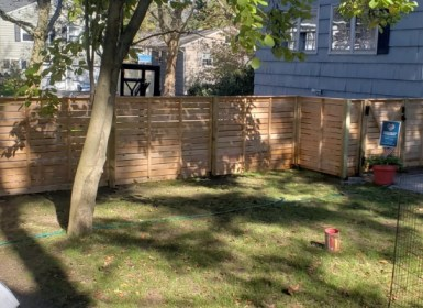 Horizontal wood fence in residential yard