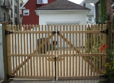 Wooden picket fence double driveway gate doors