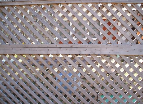 Diagonal wood lattice fence