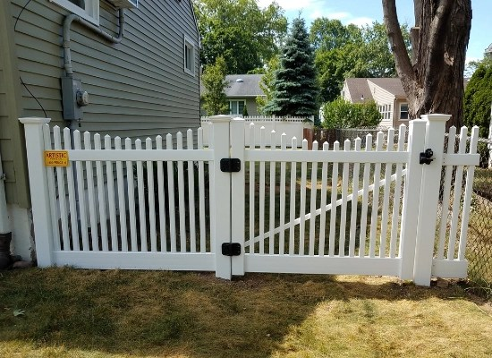white picket fence gate door with scalloped top