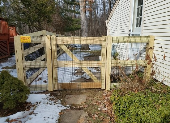 3 rail, flat rail, post and rail fence with wire and a gate installed by Artistic Fence Company