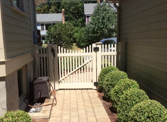Beige vinyl picket fence and gate