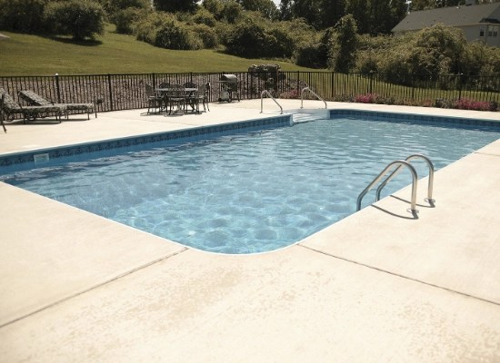 In the ground swimming pool with aluminum fencing