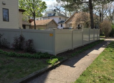 Grey Privacy fence with 4ft and 5ft height sections