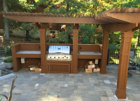 Custom wood pation pergola with housing for outdoor grill and outdoor counter space