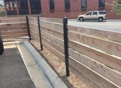 Horizontal wood fence with aluminum posts