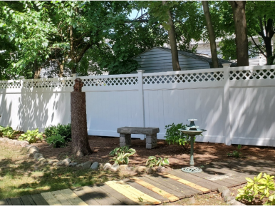 Suburban Lattice PVC fence - Diagonal lattice topper for vinyl fence installed by Artistic Fence of Northern New Jersey