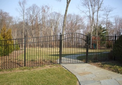 Aluminum fence and crowned gate over a walkway