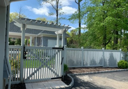 Arbor, gate, and fence permanently installed on a residential property in New Jersey by Artistic fence that required an ST-8 form