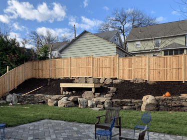 #220 solid Wood fence in a back yard in New Jersey