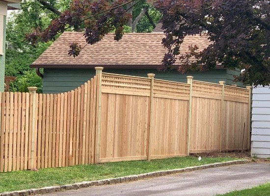 Solid wood fence with square lattice top installed in Montclair, NJ by Artistic Fence Company   Style #221