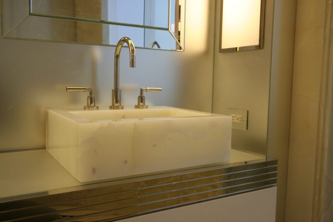 Master bathroom carved sink in white onyx