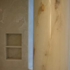 Master bathroom shower floor, walls, niche and column in white onyx