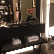 His bathroom custom floating sink top and bowl in black granite